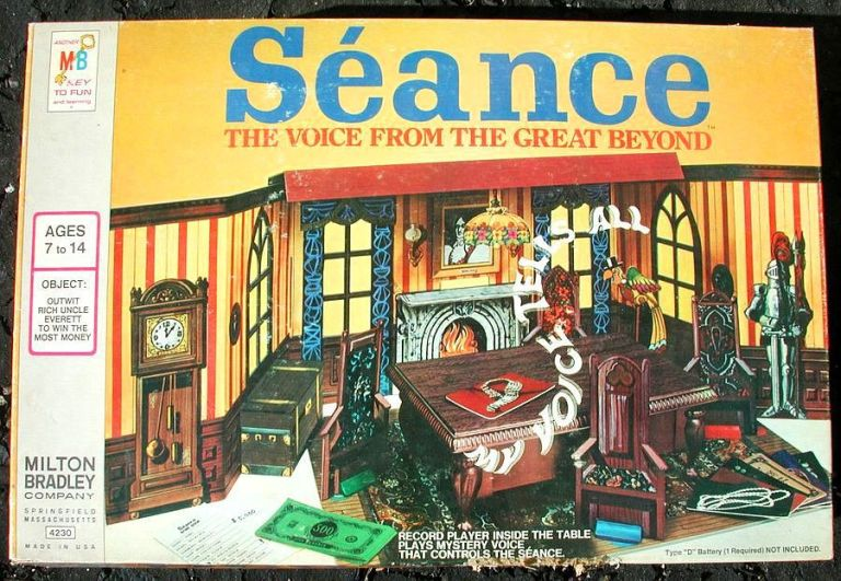 Image of the board game box, which shows an old english-looking room with a grandfather clock, suit of armor, fireplace, and red and yellow wallpaper, plus other gameplay items.